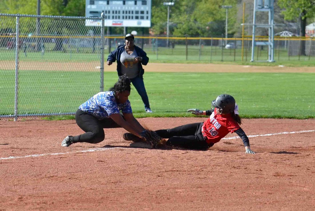 . Paul DiCicco - The News-Herald  Mentor\'s Meri Bobrovsky slides in safely at third under the tag of Sumayah Abdullah.