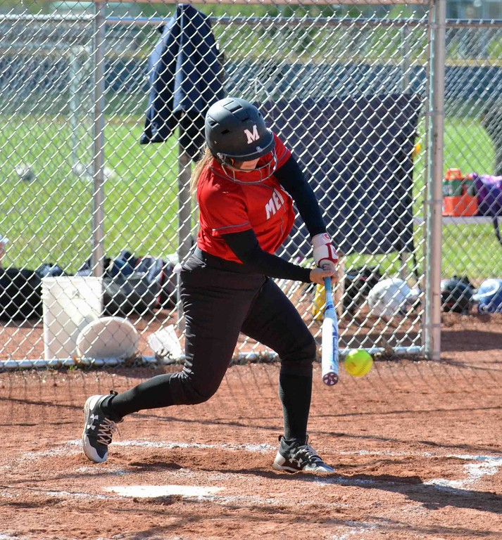 . Paul DiCicco - The News-Herald - Mentor Senior, Gianna Sluga, connecting on a single in the second inning.