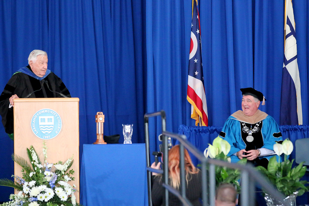 . Jonathan Tressler � The News-Herald <br> Lakeland Community College President, Morris Beverage, right, reacts May 13 during the school\'s 50th Annual Commencement as the school\'s very first president, Wayne L. Rodehorst, cracks wise during his keynote address.