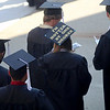 Jonathan Tressler — The News-Herald <br> A soon-to-be Lakeland Community College graduate sports one example of the many creatively festooned mortar boards displayed during the school's 50th Annual Commencement May 13.
