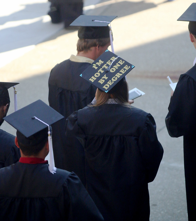. Jonathan Tressler � The News-Herald <br> A soon-to-be Lakeland Community College graduate sports one example of the many creatively festooned mortar boards displayed during the school\'s 50th Annual Commencement May 13.