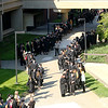 Jonathan Tressler — The News-Herald <br> Soon-to-be Lakeland Community College graduates, faculty and administrators line up in the main courtyard on the school's Main Campus in Kirtland prior to Lakeland's 50th Annual Commencement May 13.