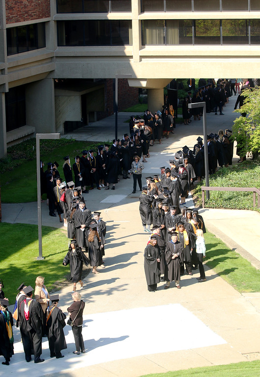 . Jonathan Tressler � The News-Herald <br> Soon-to-be Lakeland Community College graduates, faculty and administrators line up in the main courtyard on the school\'s Main Campus in Kirtland prior to Lakeland\'s 50th Annual Commencement May 13.