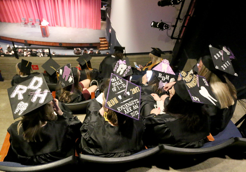 Jonathan Tressler — The News-Herald <br> Some more creative mortar boards make their appearances May 13 in the Dr. Wayne L. Rodehorst Performing Arts Center as soon-to-be graduates receive instructions about commencement.