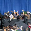 Jonathan Tressler — The News-Herald <br> Lakeland Community College graduates give a sign of solidarity as their contemporaries are recognized during the school's 50th Annual Commencement May 13.