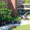 Jonathan Tressler — The News-Herald <br> Soon-to-be Lakeland Community College graduates line up pre-graduation May 13 in the main courtyard of the school's Kirtland Campus during preparations for the school's 50th Annual Commencement.
