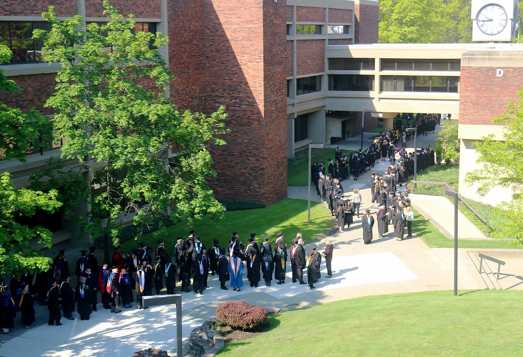 . Jonathan Tressler � The News-Herald <br> Soon-to-be Lakeland Community College graduates line up pre-graduation May 13 in the main courtyard of the school\'s Kirtland Campus during preparations for the school\'s 50th Annual Commencement.