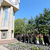 Jonathan Tressler — The News-Herald <br> The line of soon-to-be Lakeland Community College graduates snakes past the school's characteristic clock tower May 13 shortly before the school's 50th Annual Commencement commences.
