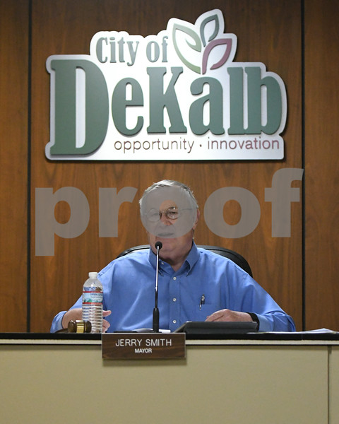 Dekalb Mayor Jerry Smith tries to help clarify an answer that was asked by an Aldermanic Ward.