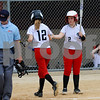 Autumn Johanningsmeier (2) greets Indian Creek teammate Jade Milostan (12) at home plate after Milostan scored against Paw Paw on Monday, May 14 in Shabbona.  Steve Bittinger - For Shaw Media