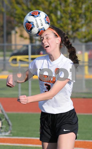 Olivia Olson heads the ball during regional soccer action in DeKalb on Tuesday.  Steve Bittinger - For Shaw Media