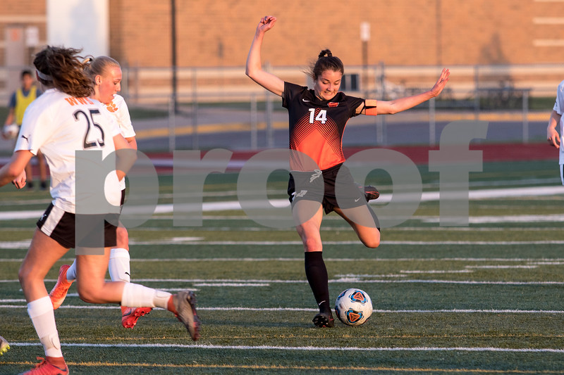 Sam Buckner for Shaw Media.<br /> Bella Bettner takes a shot on goal during the regional game aggainst Wheaton Warrenville South on Tuesday May 16, 2017.
