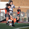 Sam Buckner for Shaw Media.<br /> Maddie Hill kicks the ball downfield during the regional game on Tuesday May 16, 2017 against Wheaton Warrenville South.