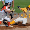 Jacobs baserunner Katie Armstrong beats the tag by DeKalb secondbaseman Amanda DuBeau on Thursday in DeKalb.  Steve Bittinger - For Shaw Media
