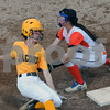 DeKalb thirdbaseman Mallory Warner tags out Sarah Lynch of Jacobs on Thursday in DeKalb.  Steve Bittinger - For Shaw Media