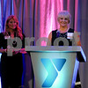 Karen Pletsch (right) receives the 2018 Outstanding Community Leader Award at the Y Community Awards Dinner on Thursday, May 17 in DeKalb.  Steve Bittinger - For Shaw Media