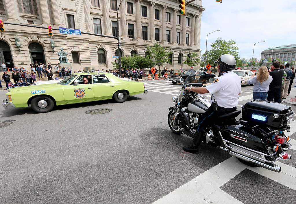 . Jonathan Tressler � The News-Herald <br> An old-school Cleveland Police patrol car passes by one of the latest-model police motorcycles available during the 32nd Annual Greater Cleveland Peace Officers Memorial Parade and Memorial Service in Downtown Cleveland May 19.