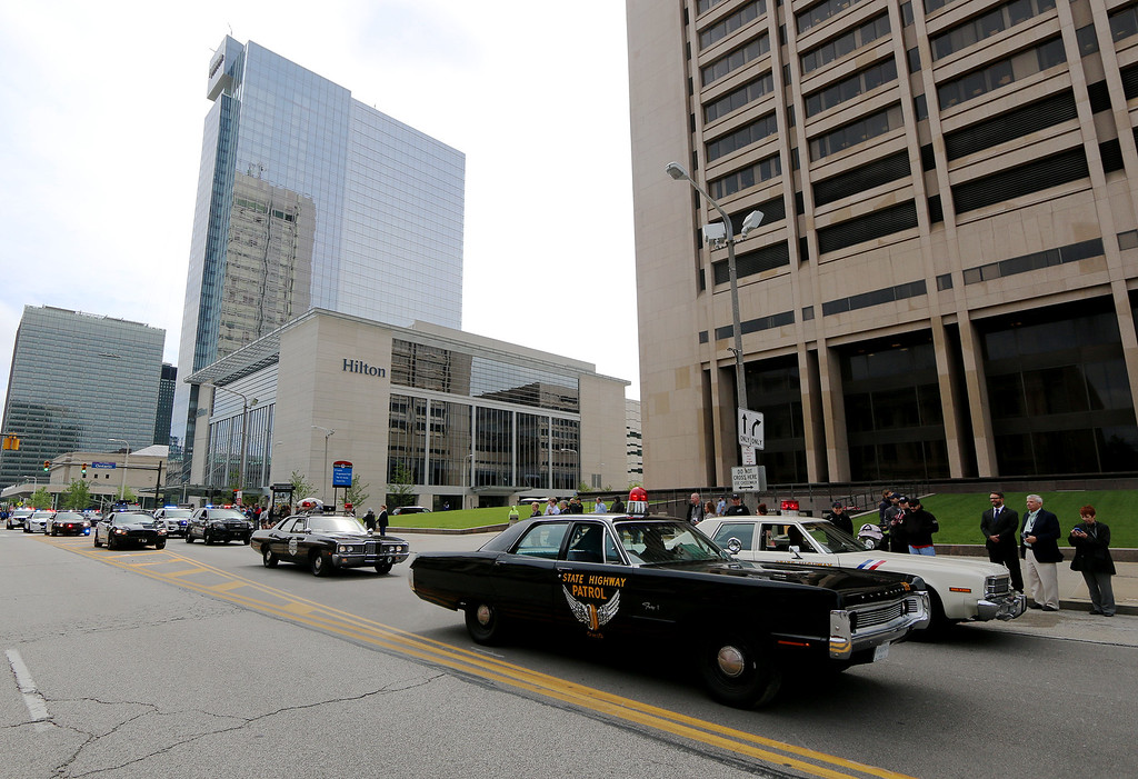 . Jonathan Tressler � The News-Herald <br> Some old-school police cruisers cruise Lakeside Avenue May 19 during the 32nd Annual Greater Cleveland Peace Officers Memorial Parade and Memorial Service in Downtown Cleveland.