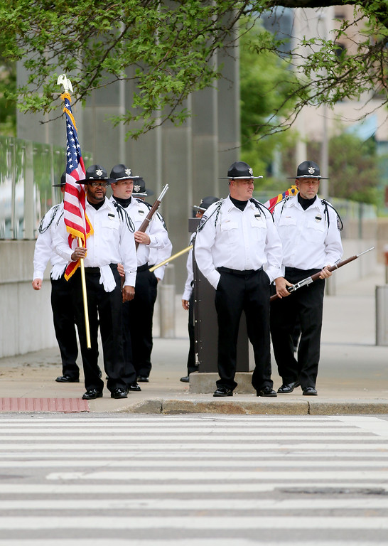 . Jonathan Tressler � The News-Herald <br> A honor guard from the Mansfield Correctional Institution waits to cross E. 9 Street along Lakeside Avenue in Cleveland as it makes its way to the parade step-off point May 19 during the 32nd Annual Greater Cleveland Peace Officers Memorial Parade and Memorial Service.