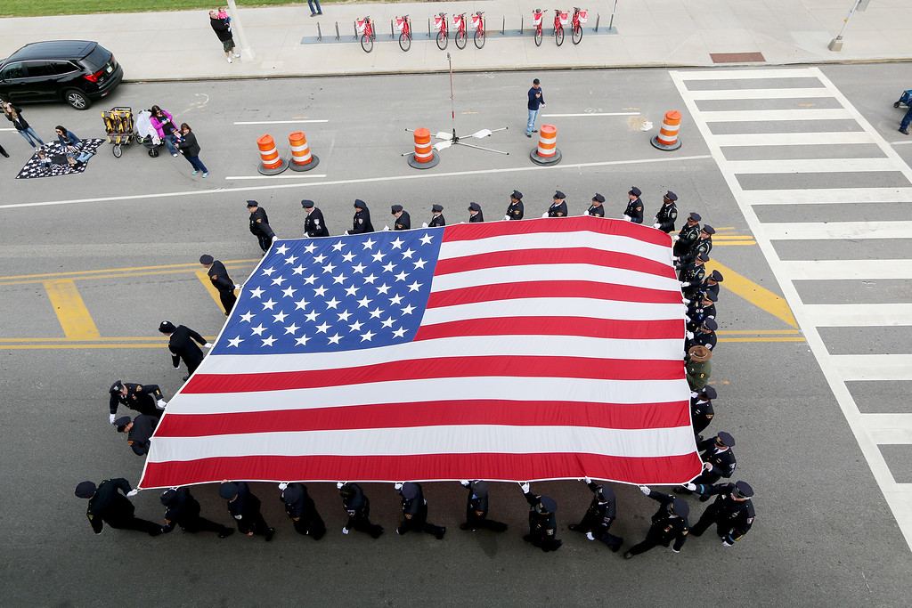 . Jonathan Tressler � The News-Herald <br> The 40-person flag from Painesville Elks Lodge #549, seen from above Lakeside Avenue in Cleveland atop the convention center observatory, makes its yearly appearance during the 32nd Annual Greater Cleveland Peace Officers Memorial Parade and Memorial Service in Downtown Cleveland May 19.