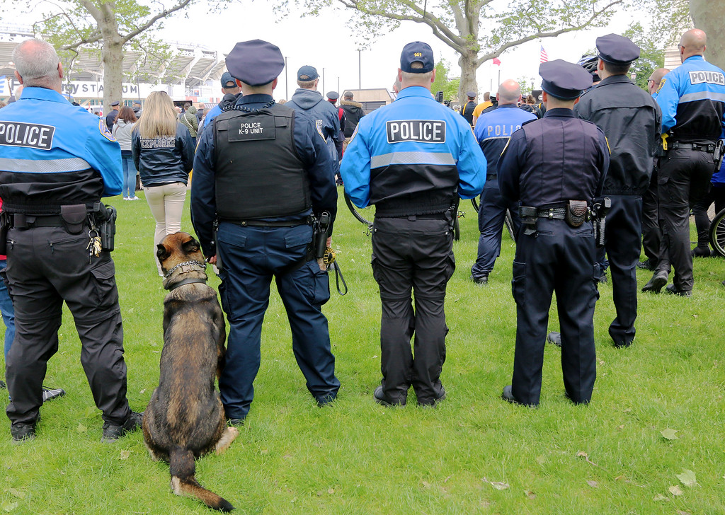 . Jonathan Tressler � The News-Herald <br> Officers of different assignments - and species - pause to commemorate their fallen brothers and sisters May 19 during the 32nd Annual Greater Cleveland Peace Officers Memorial Parade and Memorial Service in Downtown Cleveland.