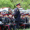 Jonathan Tressler — The News-Herald <br> An officer from the Waterloo Regional Police in Ontario, Canada, stands at ease during the conclusion of the Greater Cleveland Peace Officers Memorial Parade and Memorial Service in Downtown Cleveland May 19 as the agency's band is seated behind him.