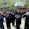 Jonathan Tressler — The News-Herald <br> Public safety personnel and the public participate in honoring America as its Anthem is performed May 19 during the 32nd Annual Greater Cleveland Peace Officers Memorial Parade and Memorial Service in Downtown Cleveland.