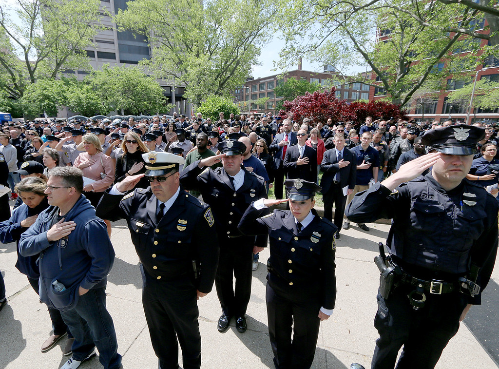 . Jonathan Tressler � The News-Herald <br> Public safety personnel and the public participate in honoring America as its Anthem is performed May 19 during the 32nd Annual Greater Cleveland Peace Officers Memorial Parade and Memorial Service in Downtown Cleveland.