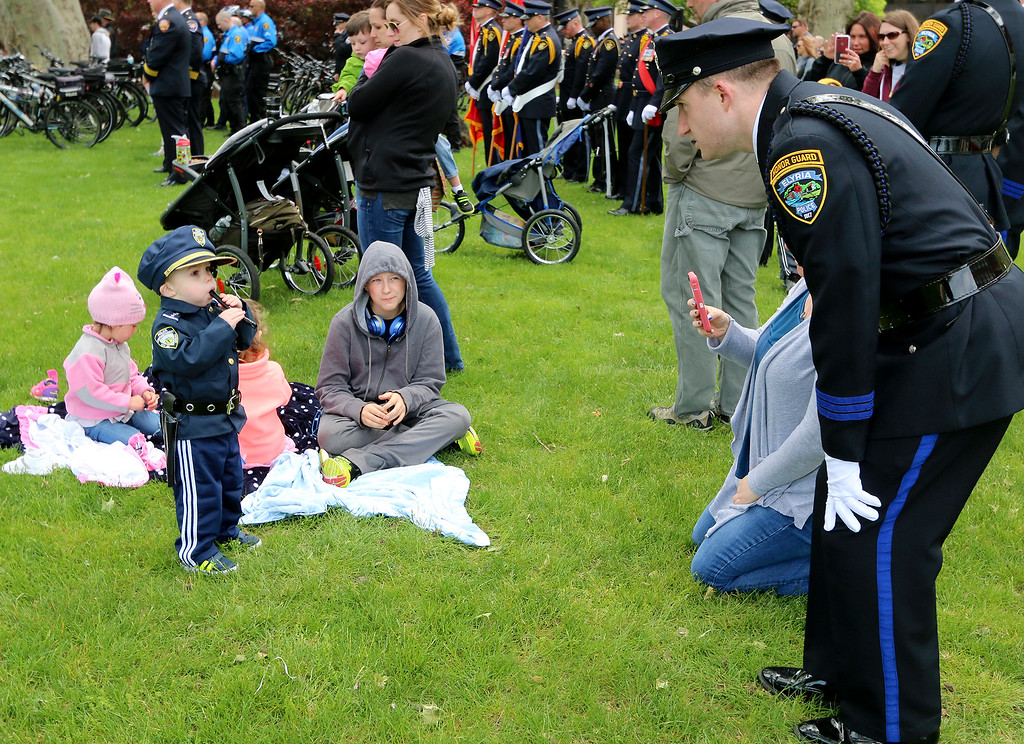 . Jonathan Tressler � The News-Herald <br> Prospective pipes-and-drums player Frankie Mahony, 2, practices his cadence may 19 at Huntington Park in Cleveland during the 32nd Annual Greater Cleveland Peace Officers Memorial Parade and Memorial Service in Downtown Cleveland as his dad - Elyria police Patrolman Mike Mahony - eggs him on.