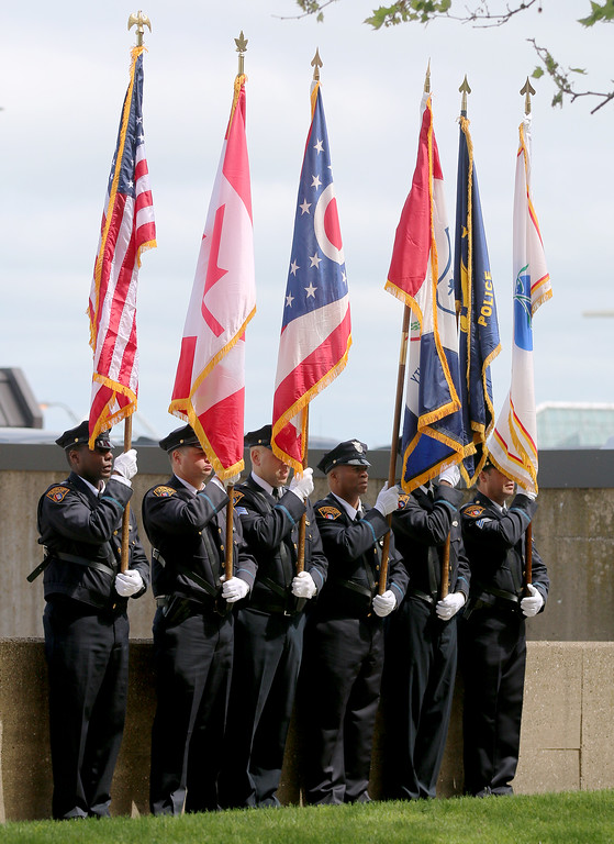 . Jonathan Tressler � The News-Herald <br> Part of the Cleveland Police Department\'s Honor Guard fly their flags high as the Greater Cleveland Peace Officers Memorial Parade and Memorial Service in Downtown Cleveland moves into the memorial portion of the event May 19.