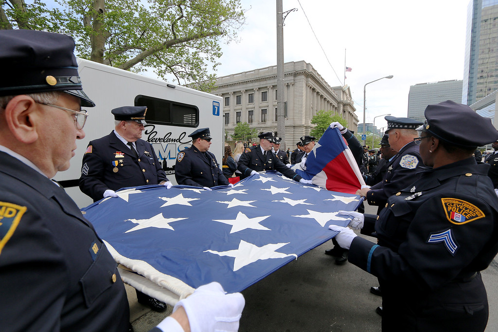 . Jonathan Tressler � The News-Herald <br> The big-flag-carrying contingent of the 32nd Annual Annual Greater Cleveland Peace Officers Memorial Parade and Memorial Service in Downtown Cleveland fold Old Glory properly following the parade May 19.