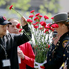 Jonathan Tressler — The News-Herald <br> Family and friends of fallen police officers place roses in honor of their loved ones May 19 during the 32nd Annual Greater Cleveland Peace Officers Memorial Parade and Memorial Service in Downtown Cleveland.
