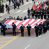 Jonathan Tressler — The News-Herald <br> Officers from a variety of public safety agencies carry a huge American Flag down Lakeside Avenue towards the Greater Cleveland Peace Officers Memorial at Huntington Park May 19 during the 32nd Annual Annual Greater Cleveland Peace Officers Memorial Parade and Memorial Service in Downtown Cleveland.