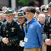 Jonathan Tressler — The News-Herald <br> Christian Lorenzo Velez, son of fallen Ohio Highway Patrol Trooper Kenneth Velez stands among numerous highway patrol troopers and other Northeast Ohio public safety officers in preparation to accompany a wreath-placement procession in his father's honor May 19 during the 32nd Annual Greater Cleveland Peace Officers Memorial Parade and Memorial Service in Downtown Cleveland.