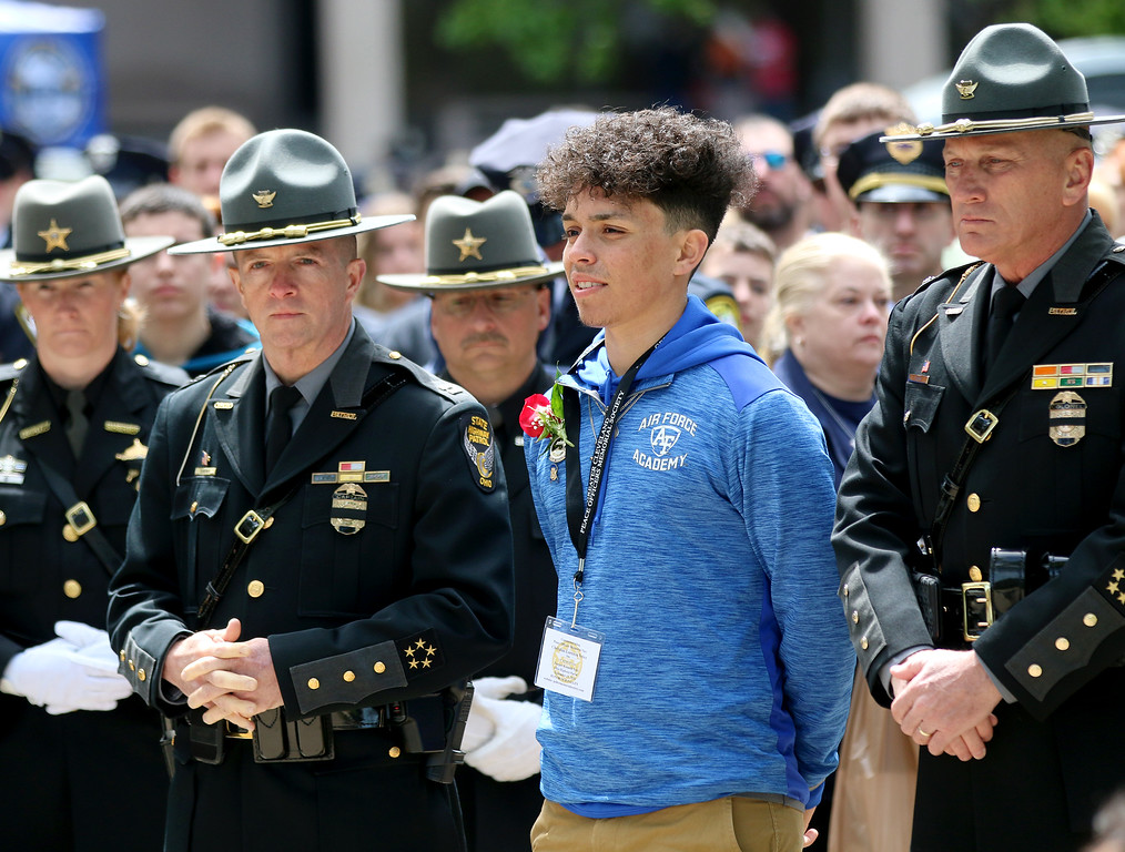 . Jonathan Tressler � The News-Herald <br> Christian Lorenzo Velez, son of fallen Ohio Highway Patrol Trooper Kenneth Velez stands among numerous highway patrol troopers and other Northeast Ohio public safety officers in preparation to accompany a wreath-placement procession in his father\'s honor May 19 during the 32nd Annual Greater Cleveland Peace Officers Memorial Parade and Memorial Service in Downtown Cleveland.
