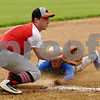 Indian Creek third baseman Brendan Wortman waits for a throw as Jake Willette of Somonauk slides safely into third base during regional action in Big Rock on Saturday, May 19.   Steve Bittinger - For Shaw Media