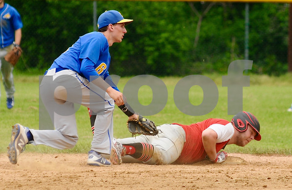 Brady Kreiter of Somonauk is late with the tag on Jordan Morris of Indian Creek during regional action in Big Rock on Saturday, May 19.   Steve Bittinger - For Shaw Media