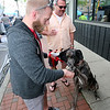 Jonathan Tressler — The News-Herald <br> Meat lovers Josh Lavelle and his dog, Ulysses, a 14-month-old, 135-pound Great Dane, share a fist-bump after Ulysses got a meat-treat May 20 during the sixth-annual Downtown Willoughby Rib Burn Off.