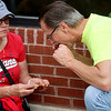 Jonathan Tressler — The News-Herald <br> Chester Township residents Jan, left, and Phil Slosar chow down on some ribs in Downtown Willoughby May 20 during the sixth-annual Downtown Willoughby Rib Burn Off.