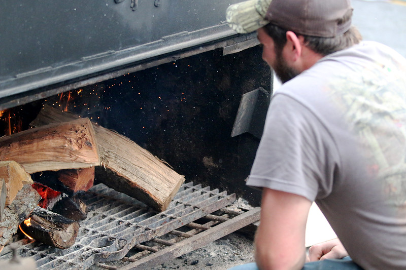 Jonathan Tressler — The News-Herald <br> Where good ribs are concerned, it's all about the burn.