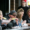 Jonathan Tressler — The News-Herald <br> Grilled-food enthusiasts chomp on ears of corn near Taco Local at the sixth annual Downtown Willoughby Rib Burn Off May 20.
