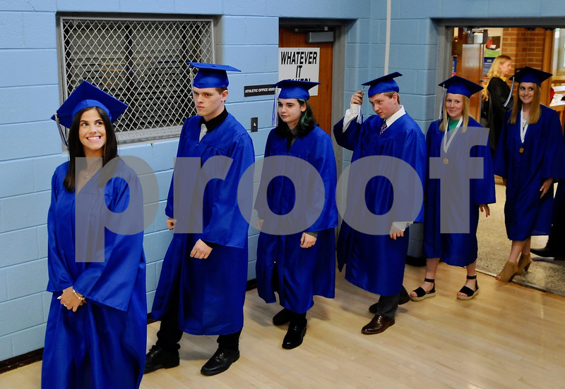 Hinckley-Big Rock High School graduates file into the gymnasium for commencement ceremonies on Sunday in Hinckley.  Steve Bittinger - For Shaw Media