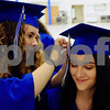 Kara Runyan (left) helps fellow graduate Katie O'Dwyer with her cap before the start of commencement ceremonies at Hinckley-Big Rock High School on Sunday.  Steve Bittinger - For Shaw Media