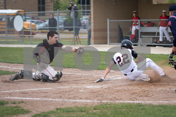 Sam Buckner for Shaw Media.<br /> Ryne Kerschke slides into home on a bunt from Matthew Searles on Monday May 22, 2017 against Rockford Jefferson.