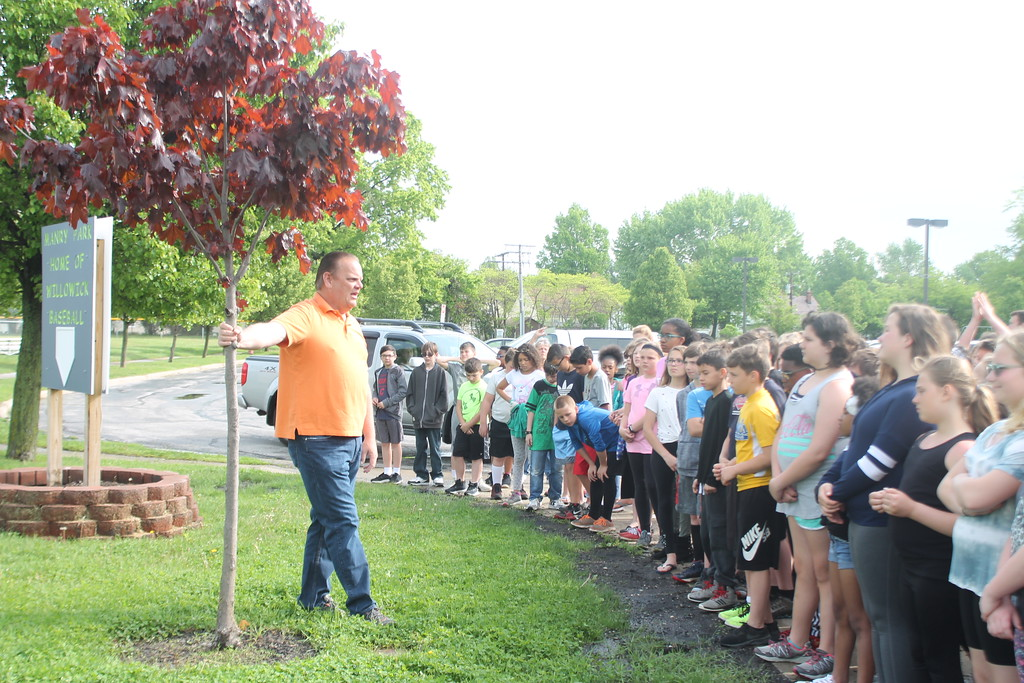 . Kristi Garabrandt � The News-Herald <br> Willowick Mayor Rich Regovich points out to the fifth graders from Royalview Elementary School that the first tree planted  in the Manry Park by students was planted by the current graduation seniors.  Fifth graders planting a tree each year has become a tradition the mayor plans to continue with.