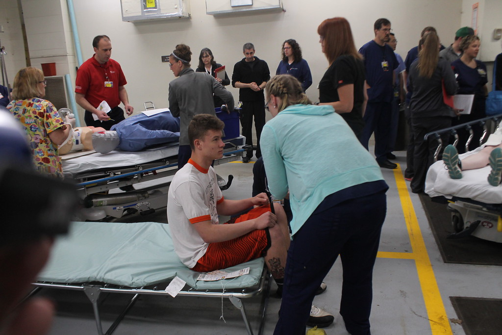 . Emergency room nurses and doctors start triage on some of the 20 victims of a staged mass shooting as they every every three minutes for one hour  as part of  the disaster drill held by University Hospital Geauga Medical Center on May 23. Kristi Garabrandt - The News-Herald