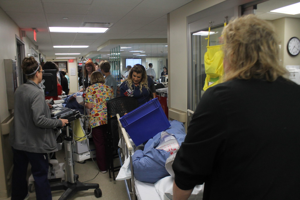 . The emergency room hallways start to get full as emergency room nurses start to transport some of the victims of a staged mass shooting to the X-ray department and operating rooms as part of  the disaster drill held by University Hospital Geauga Medical Center on May 23. Kristi Garabrandt - The News-Herald