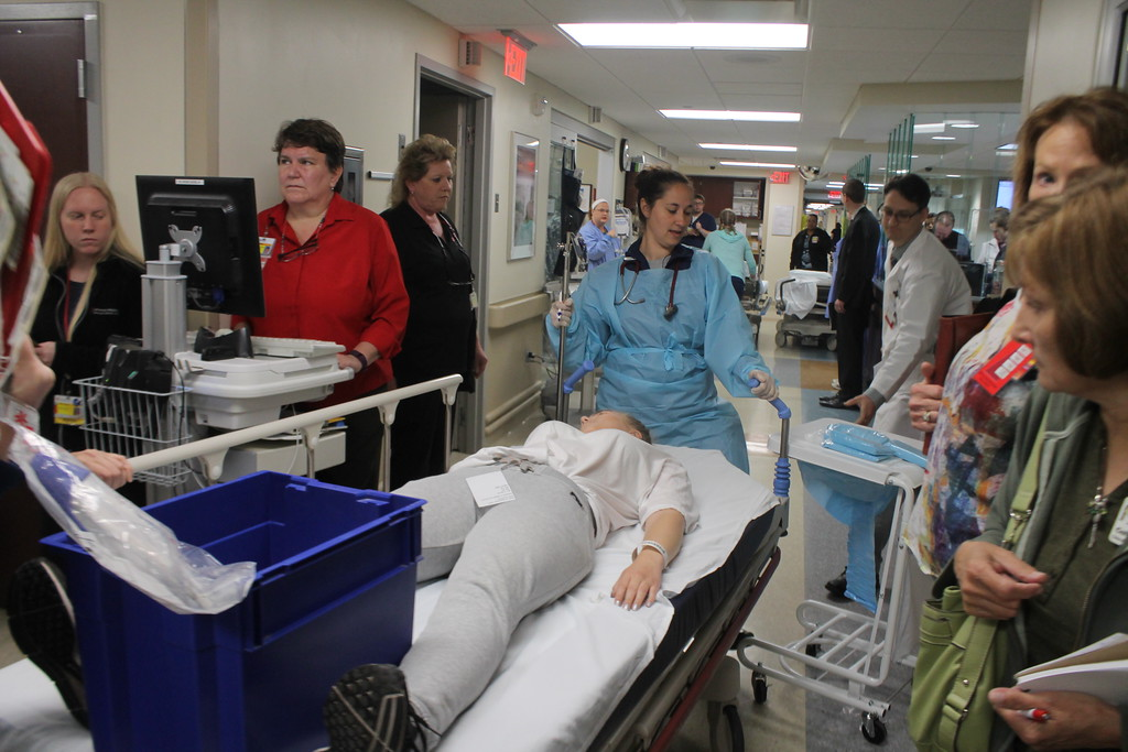 . Emergency room nurses start to transport some of the victims of a staged mass shooting to the X-ray department and operating rooms as part of  the disaster drill held by University Hospital Geauga Medical Center on May 23. Kristi Garabrandt - The News-Herald