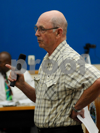 South Grove Township resident Larry Smith voices his concerns during the DeKalb County Planning and Zoning Committee meeting regarding wind turbines on Wednesday, May 23.  Steve Bittinger - For Shaw Media