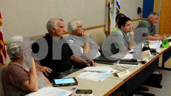 Members of the DeKalb County Planning and Zoning Committee listen as area residents voice their concerns regarding wind turbines on Wednesday, May 23 in Sycamore.  Steve Bittinger - For Shaw Media